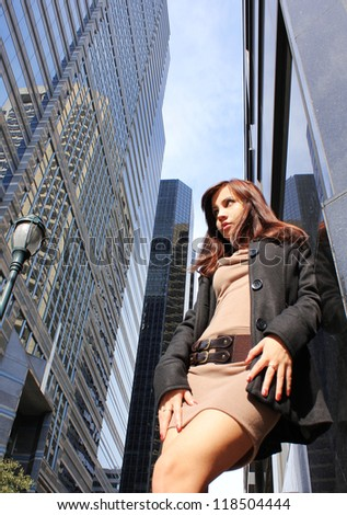 fashion girl in sexy urban outfit posing around high buildings in big city