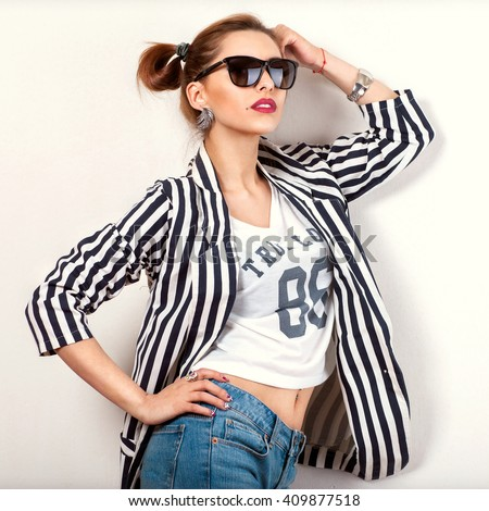 fashion girl in studio near white background smiling emotionally sunglasses. Vogue Style - stock photo