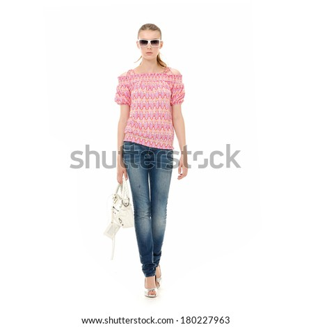 fashion girl in sunglasses and in jeans show in studio,