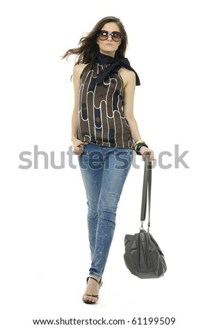 Fashion girl in sunglasses and in jeans show in studio - stock photo