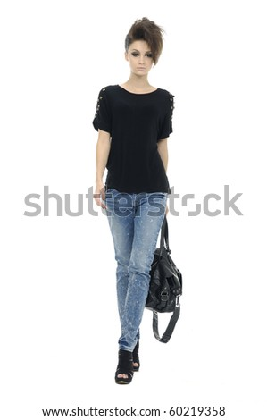 Fashion girl in sunglasses and jeans show in studio - stock photo