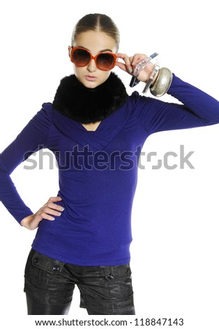 Fashion girl in sunglasses in scarf, isolated