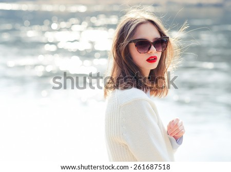 fashion girl in sunglasses. vacation at sea - stock photo