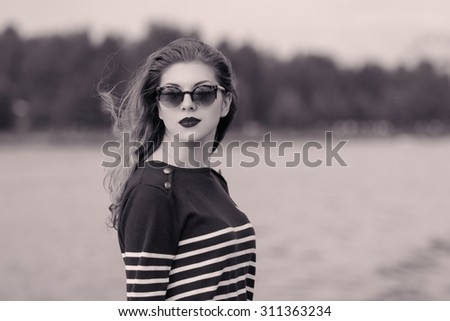 fashion girl in sunglasses. vacation at sea - stock photo