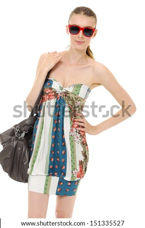 fashion girl in sunglasses with bag in studio,