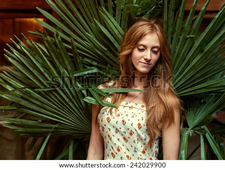 fashion girl in tropical palm leaves - stock photo