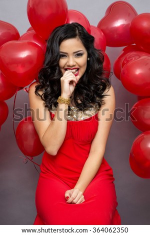 Fashion girl model  with red ballons. - stock photo