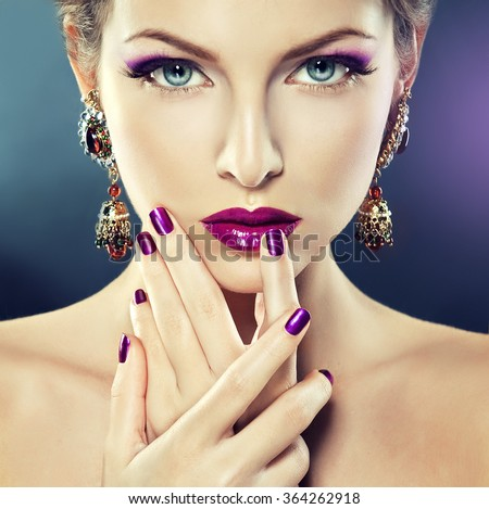 Fashion Girl Portrait . Beautiful girl model with purple makeup and manicure  on the nails . - stock photo