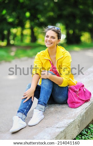 Fashion girl portrait. Beautiful happy woman in colorful clothes  - stock photo