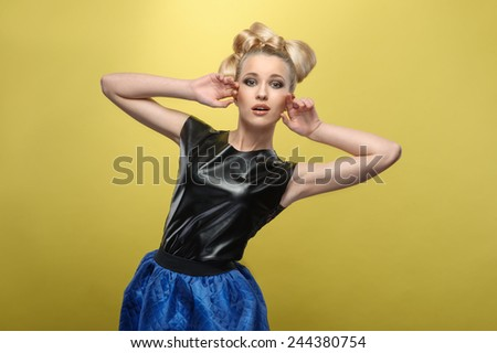 fashion girl. Portrait of surprised  beautiful young woman scraming at the camera. Studio shot - stock photo