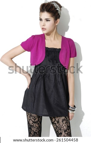 Fashion girl posing in light background - stock photo