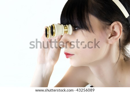 Fashion girl posing with binocular on white background