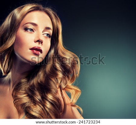 Fashion Girl with beautiful curl and shiny brown hair - stock photo