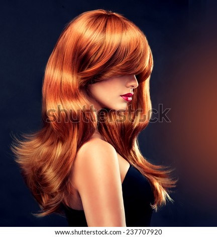 Fashion Girl with beautiful curl and shiny red hair - stock photo