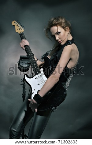 Fashion girl with guitar playing hard-rock! - stock photo