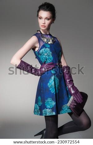 fashion girl with handbag posing on light background - stock photo