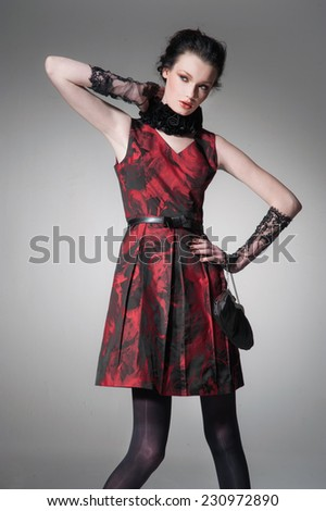 fashion girl with handbag posing on light background - stock photo