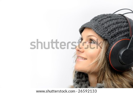 fashion girl with winter clothes and headphones - stock photo