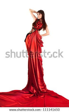 fashion glamour girl with long hairs in the red long dress - stock photo