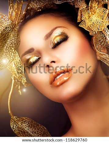 Fashion Glamour Makeup. Glamor Golden Make-up.Holiday Gold Makeup - stock photo