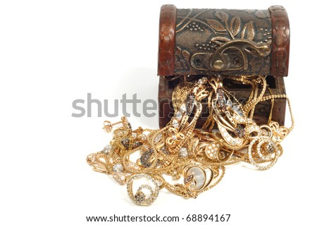 Fashion gold jewelry in wooden box, isolated on white background - stock photo