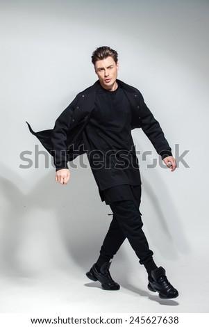 fashion guy in the studio, attractive man - stock photo