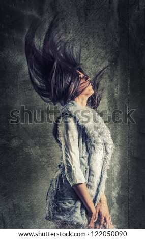 Fashion hairstyle girl with textured background and flying hair - stock photo