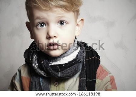 fashion handsome little boy in scarf.stylish haircut.fashion children ...