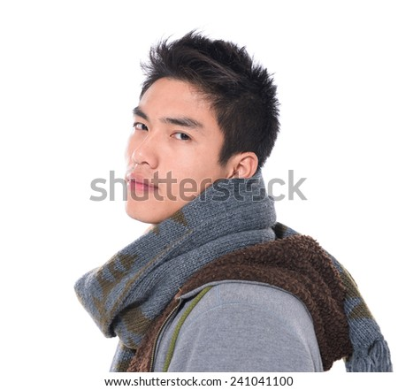Fashion handsome young man with scarf posing in studio - stock photo