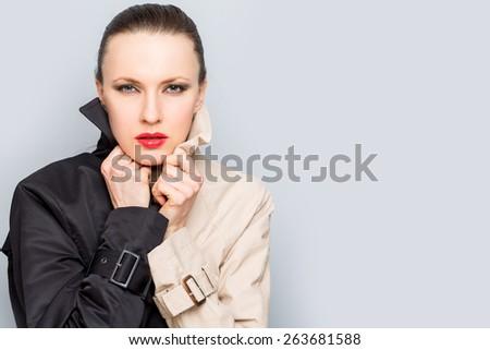 Fashion image of lady in trendy rain coat - stock photo