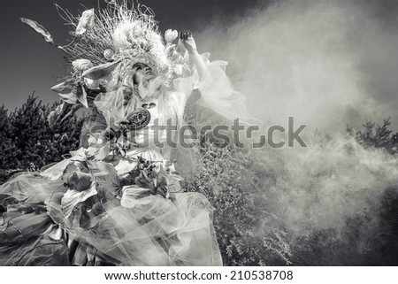 Fashion image of sensual girl in bright fantasy stylization. Black-white outdoor fairy tale art photo. - stock photo
