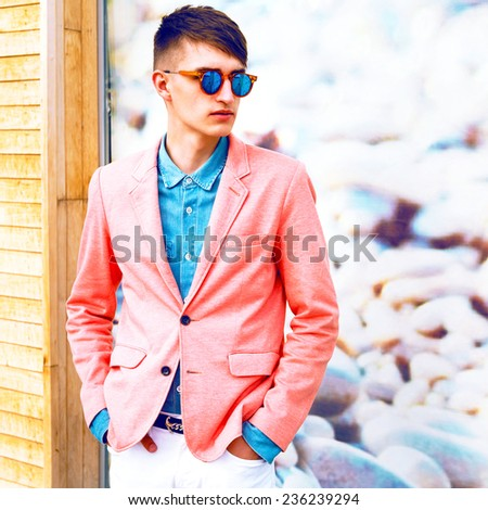 Fashion image of young stylish handsome hipster guy, wearing trendy suit and sunglasses. - stock photo