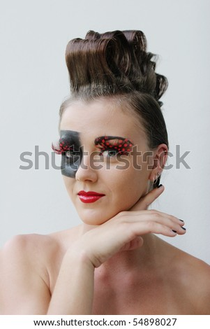 Fashion image with bold make-up and modern hairstyle.
