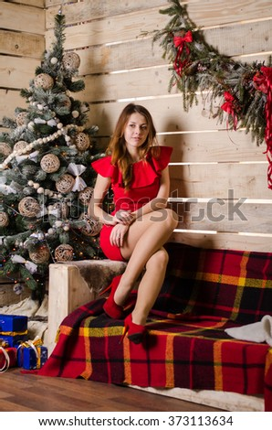 fashion interior photo of beautiful sexy girls with blond hair wear luxurious party dresses and Santa hats,holding glasses with champagne in hands,celebrating New Year - stock photo