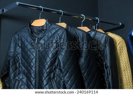 fashion jacket on hangers - stock photo