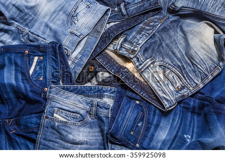 Fashion jeans laying on each other - stock photo