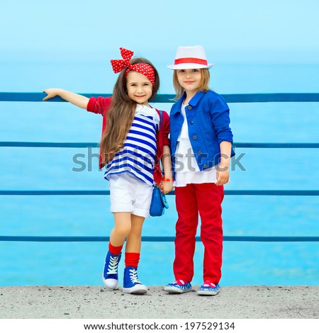 Fashion kids resting on the sea . Vacation, friendship, fashionable concept. - stock photo