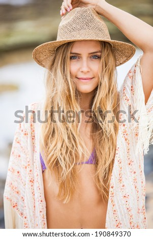 Fashion lifestyle, Beautiful young woman outdoors portrait. Soft warm colors.  - stock photo