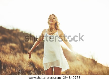 Fashion Lifestyle. Fashion Portrait of Beautiful Young Woman Outdoors. Soft warm vintage color tone. Artsy Bohemian Style. - stock photo