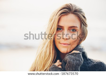 Fashion lifestyle, Portrait of beautiful girl close-up with amazing eyes. Woman on the beach at sunset. - stock photo