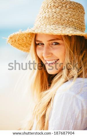 Fashion lifestyle, Portrait of beautiful happy blond girl on the beach - stock photo