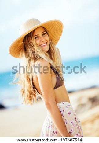 Fashion lifestyle, Portrait of beautiful happy girl at the beach with sun hat - stock photo