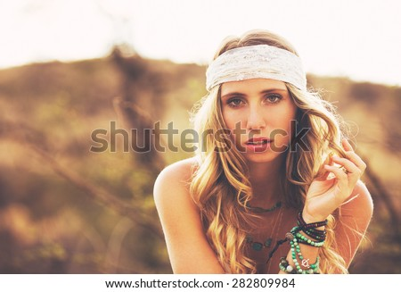 Fashion Lifestyle, Portrait of Beautiful Young Woman Backlit at Sunset Outdoors. Soft warm colors. - stock photo