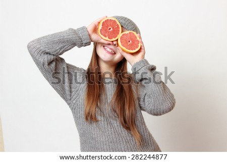 Fashion little girl holding grapefruit