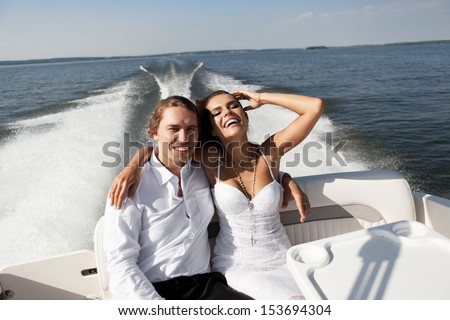 http://thumb1.shutterstock.com/display_pic_with_logo/719740/153694304/stock-photo-fashion-lovely-beautiful-couple-smiling-on-the-luxury-boat-in-open-sea-in-summer-young-man-and-153694304.jpg