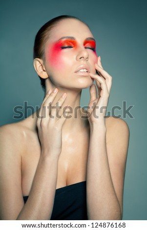 Fashion make-up. Face art. Beauty. Female portrait. Model face with magic creative fashion multicolored make-up. Perfect skin.Face painting, cosmetics, beauty and make up.Background.Space.Actress  - stock photo