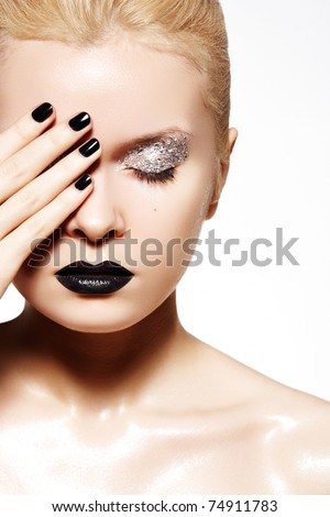 Fashion make-up. Shiny oil skin, black lips, nails