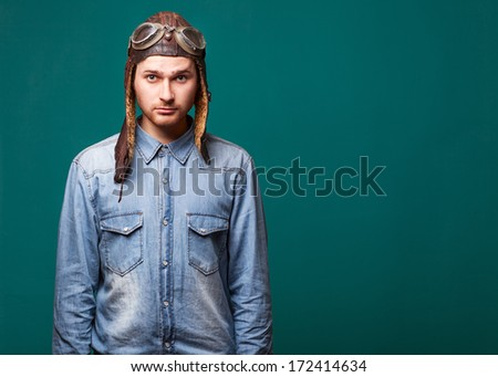 fashion male pilot in the studio