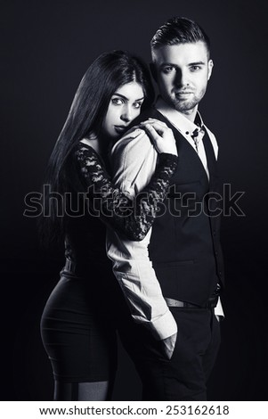 fashion man and woman love couple portrait. vogue style vintage photo. Classic wear elegance.