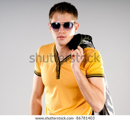 fashion man in sunglasses on grey background